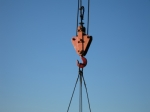 Hook of building crane lifting cargo